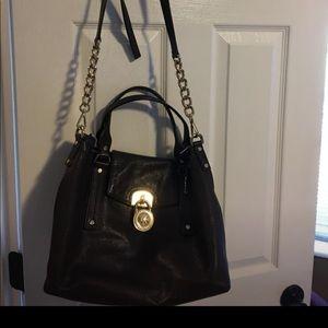 Dark brown crossbody MK bag.